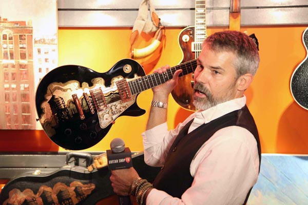 Gibson Custom Artist in Residence, James A. Willis, holding the one-of-a-kind Midnight City Special, interviewed by Guitar Shop TV